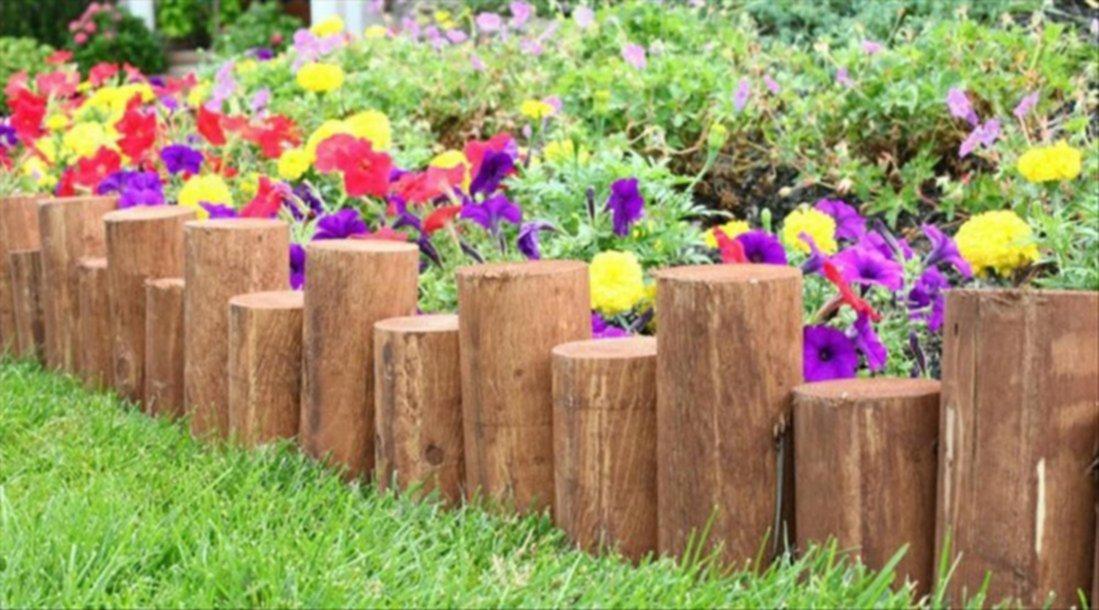 Estacas de madera para crear vallas en el jard n - Vallas decorativas para jardin ...